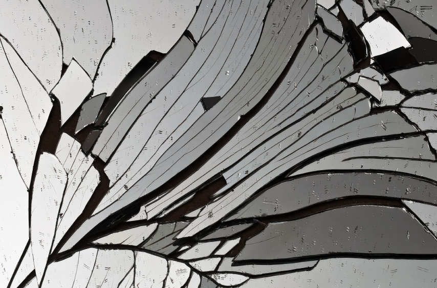 A closeup shot of a broken mirror.